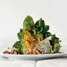 We'll admit it—we all love a wedge of iceberg with blue-cheese dressing. So there's no need to apologize for serving this beautiful plate of sweet lettuce, slices of good Stilton, and toasted walnuts, along with an excellent vinaigrette that brings out the best in all of them.