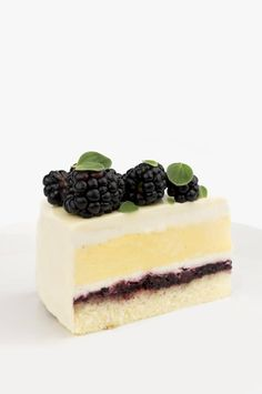 Blackberry, honey, and saffron entremet cake with blackberry coulis, sponge cake, honey mousse, and saffron crème brûlée. All glazed with white chocolate. Inspired by Nadege Bakery's La Mancha cake.