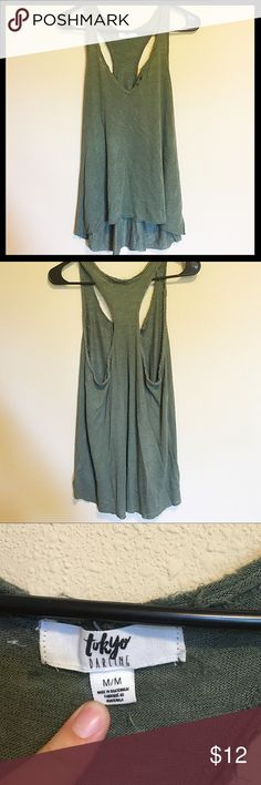 Olive green super soft racerback tank Super soft olive green tank with small button detail on front. Size medium, flowy so runs big tokyo darling Tops Tank Tops