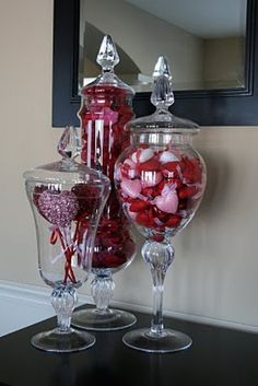 We could also do something like this on the mantel or the directors table with valentines candies and/or rose petals.