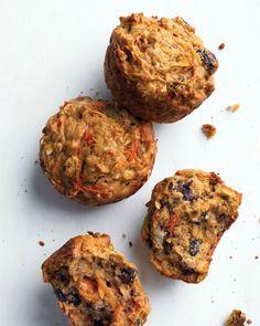 Healthy Morning Muffins: 1 1/4C all-purpose flour - 1/2C packed dark-brown sugar - 1/2 tsp baking soda - 1/2 tsp baking powder - 1/2 tsp ground nutmeg - 1/2 tsp salt - 1C rolled oats - 1/2C raisins - 3T extra-virgin olive oil - 1 egg - 1/3C skim milk - 4 med. carrots, shredded - 1 med. ripe banana