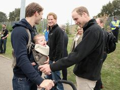 Prince William, Duke of Cambridge and Prince Harry meet a baby named Elliot Invictus James during the Invictus Games athletics at Lee Valley on September 11, 2014 in London, England.