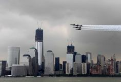 Military aircraft fly in formation in front of the lower Manhattan skyline and the World Trade Center site as seen from Jersey City, N., Wednesday, May Manhattan Skyline, Lower Manhattan, Seattle Skyline, New York Skyline, World Trade Center Site, Fleet Week, Us Military Aircraft, Navy Ships, Jersey City