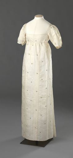 Evening Dress: ca. 1810, hand-woven binding, patterned silk, lined in cotton, embellished in satin ribbon, hand stitching.