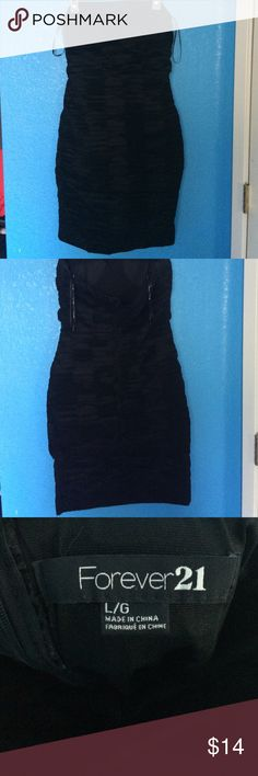 F21 Skin tight black dress Form fitting strapless dress that hits above the knee. Only worn once, may need a dry cleaning since its been in the closet for so long. Stretchy material makes this dress sexy but comfortable. Forever 21 Dresses Strapless
