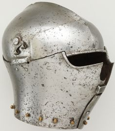 Italian armet, ca. 1430–40, steel.  In Italy from 1410 to 1510, the armet was the standard helmet for cavalry. This rare early example has flanges to protect the hinges of the cheekpieces and a staple at the front where a visor was secured. Wt. 9 lb. 7 oz. (4288 g), Met Museum.