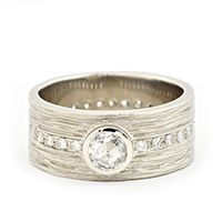 Gold bark texture band with white rose cut diamond and pave set diamonds around the band