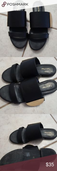 Calvin Klein leather slides Black leather with gold detailing on either side these are perfect for anything ! Loved these but were a little tight for my preference. Worn 2x in the city for a weekend Calvin Klein Shoes Sandals