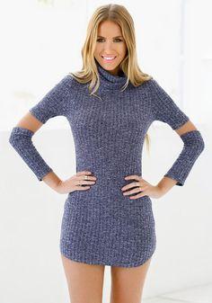 Front view of model in blue melange turtleneck tunic