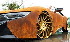 this is a rusted-out BMW 'i8′ that metrowrapz customized for music artist, austin mahone.