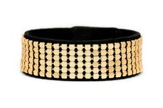 Boho Betty Gold Mesh bracelet - Dubai Dazzle collection - Get noticed with this bold, playful bracelet. Shimmering rows of metallic gold studs on jet-black faux suede mimic the opulent city skyline amidst the deep of the desert night. #LoveBohoBetty #BohoBetty #Fashion #Jewelry