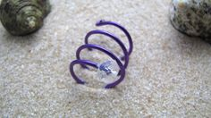 Vrisiida Handmade ring in spiral shape, made of purple aluminum wire and transparent glass bead.