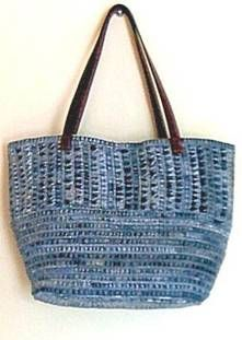composed of shades of denim blue, is made from approximately 12 pairs of secondhand jean inseams and hems. Its interesting texture is derived from the way it is pieced together, stitched in vertical and horizontal bands. The result forms a gorgeous monochromatic pattern unique to each bag. The 24-inch-long straps are made from secondhand leather belts.