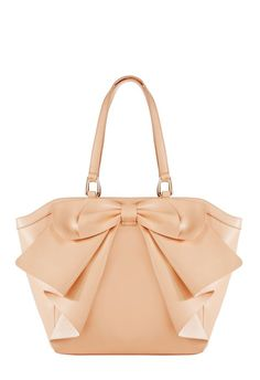 Isn't she bowtiful? Luminate by JustFab is sophisticated and fresh for the season with a naturally falling front bow.