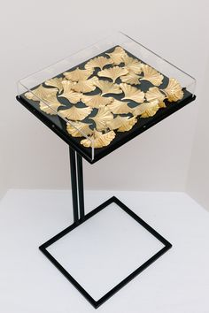 Ginkgo Cocktail Table - metal cantilevered end table / coffee table with decorative elements under glass - all right angles