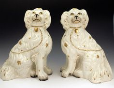 PAIR OF STAFFORDSHIRE POTTERY SPANIEL DOGS, ca. 1845.