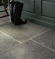 Huntingdon Limestone in a seasoned finish. Large limestone flagstones that look great on boot room floors.