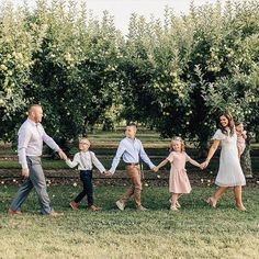 An orchard in the fall is such a fun place for family photos! Great location for this session by Summer Family Photos, Fall Family Photo Outfits, Family Maternity Photos, Fall Family Pictures, Family Picture Poses, Family Of 5, Family Photo Sessions, Cute Family, Family Posing