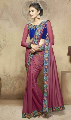 Absolute essential in your wardrobe is this embroidered sari in pink color shade viscose. Look ravishing clad in such a attire that is enhanced lace, resham and stones work. #aluuringlooksaree #awesomeeveningsarees #magentacolorsaris