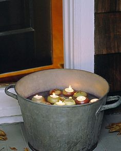 Apple Votives | Martha Stewart Living - A flotilla of apples bobbing in a steel tub evokes memories of childhood and headlong plunges into icy water.
