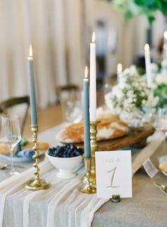 Slate blue candles and gold accents, what could be better? http://www.stylemepretty.com/2017/01/04/urban-garden-seattle-wedding/ Photography: O'Malley Photographers - http://omalleyphotographers.com/