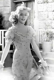 """Gloria Grahame as Violet in 'It's a Wonderful Life' (1949)    """"Oh this old thing? I only wear it when I don't care HOW I look!"""" ;)"""
