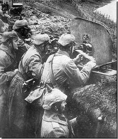 World War I -- German soldiers in a trench manning a machine gun.
