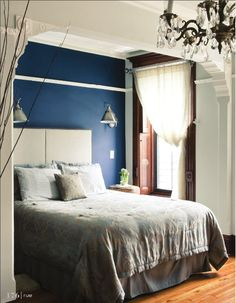 "Absolutely gorgeous and genius trim separates the ""bed room"" from the rest of the bedroom"