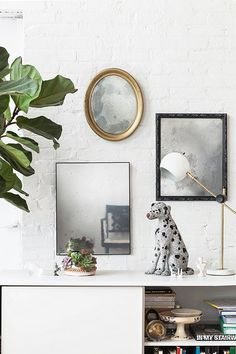 A touch of spray paint is all you need to DIY an antique finish on any mirror—seriously!