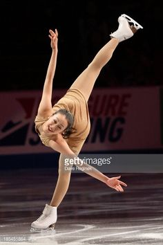 Mao Asada of Japan performs during Smucker's Skating Spectacular on day three at Skate America at Joe Louis Arena on October 20, 2013 in Detroit, Michigan.