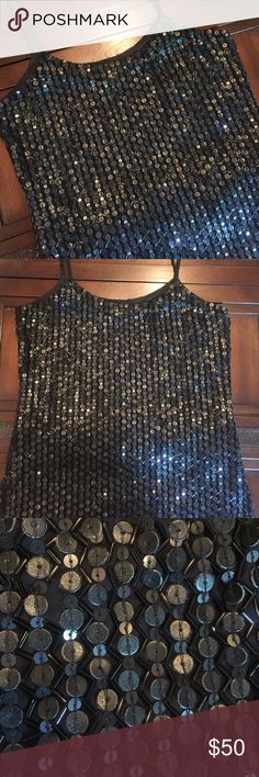 Romeo & Juliet Couture Sequin and Beaded Tank You'll definitely get noticed in this fabulous top from Romeo & Juliet Couture. Black with a variety of black sequins and beads. Size small Romeo & Juliet Couture Tops