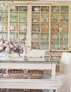 Old glass cupboards with aqua beaded board backing. | via Little Blue Deer