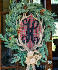 """By far the hottest ticket item of the season....This antler monogram is the perfect wall/door piece for the season! This is a custom piece that you won't find anywhere else! Choose your initial and decorate your monogram with seasonal touches or just finish it to fit in with your everyday home decor.This gorgeous monogram is .5 inch thick and cut from our Baltic Birch Plywood. Each monogram roughly measures 20"""" tall by 18"""" wide."""