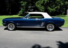 the first car I owned. a 1966 Mustang.....only in dark green metallic..trying to find a pic in green...