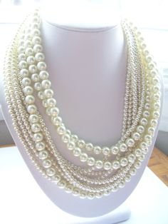 These are not finished products, this is a listing for custom orders. The pricing listed is for 1 ~ 9 strand pearl necklace. If you buy this listing you need to convo me or write in notes which necklace you would like and what colors. Prices change per amount of strands. Pearl layered twisted beaded necklace 1st layer is 16 to longest layer is 20 inches, then can be extended 3 inches more with the extender chain. Necklace has a lobster claw clasp, and 3 inch extender chain. These necklaces…