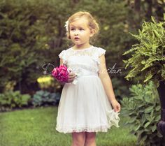 White, vintage-inspired, soft delicate lace flower girl dress with beautiful English tulle.The darling, detachable satin ribbon sash has a matching crystal and pearl embellished frayed chiffon flower.