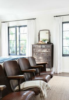 We painted the walls 'Swiss Coffee' (a pretty warm white, that goes beige if you aren't careful), and we painted the window frames that dark gray called 'Deep Space' (by Benjamin Moore).