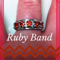 Silver Ring with Red Gemstones Brand new never worn ruby band in silver size 7 Jewelry Rings