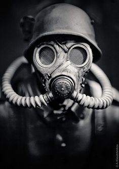 WWII German Soldier in A Gas Mask. Hitler should be given credit for seeing that gas was not used during the European war due to his own disgust with chemical warfare. He had been a gas casualty during the First World War. Gas Mask Art, Masks Art, Gas Masks, Totenkopf Tattoos, Black And White Face, Sucker Punch, War Photography, Photography Ideas, Artistic Photography