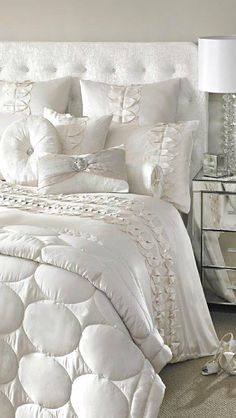 Pretty bedding. Too many frou frou pillows for me. I would stick with the basic 4 (2 Euro & 2 regular) then add a pop of color small pillows without any extra frills or ruffles. Also don't like fabric headboards.