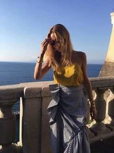 20 Best Instagram Summer Style: Mellow Yellow; @pernilleteisbaek brings high fashion to coastal living, wearing a ruffled J.W. Anderson skirt in Sorrento, Italy.