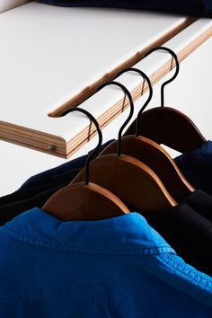 Although at first glance this would appear to be a standard Fläpps shelf, on closer inspection it doubles as a clever clothes rail. When folded, only one thin slot draws the attention to the hidden function.