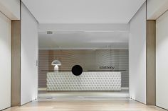 There's that tufted reception desk. Lift lobby design and branding too Corporate Office Design, Corporate Interiors, Workplace Design, Office Interiors, Interior Office, Lobby Reception, Reception Design, Reception Counter, Office Reception