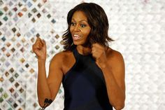 U.S. first lady Michelle Obama speaks at the start of a luncheon and panel discussion in the White House East Room during the first ever Fashion Education Workshop at the White House in Washington, October 8, 2014. REUTERS/Jim Bourg (UNITED STATES - Tags: