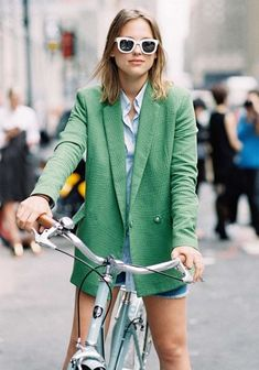 Browse these blogger-approved ways to pose with a bicycle at @Stylecaster | green blazer, white blouse, denim shorts