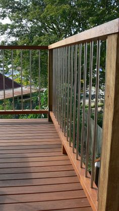 Stainless steel rod with rough-sawn hardwood posts. Great for young children!