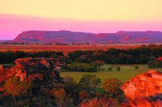 Ubirr flood plain at sunset, Kakadu National Park, Northern Territory #Australia Kakadu National Park is a three-hour drive from Darwin. Ubirr  is open from 8.30am to sunset, April 1 to November 30. Ranger-led art tours take place June-September. kakadunationalpark.com