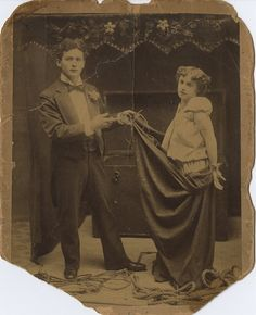 """Harry Houdini and his wife Bess performing a signature magic trick, """"Metamorphosis"""" (ca. 1895). Bess was locked inside a trunk after being restrained with ropes and put into a bag. Houdini would then stand on the trunk and hold a curtain up to conceal his entire body. When the curtain was lowered, it was now revealed to be Bess standing atop the box, having changed places instantaneously with Houdini. When the trunk was opened, it now contained Harry Houdini, restrained as Bess had been."""