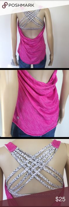 Lululemon open back workout tank Very cute and in great condition. This is pink heathered and lightweight. Attached sports bra with crisscross back and removable padding. Size 6 lululemon athletica Tops Tank Tops