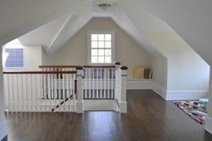 Idea of top of new attic staircase. I want a turn to terminate the long run.  Turnbuckles or solid wall with built in book cases???
